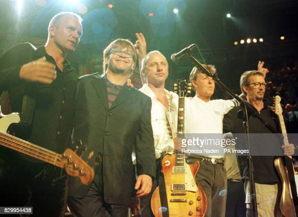 Musicians Sting Elton John Mark Knopfler Sir Paul McCartney and Eric Clapton on stage at the 'Music for Montserrat' benefit concert
