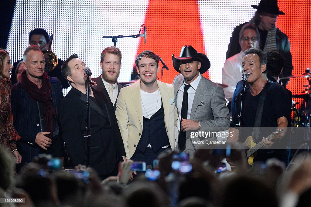Musicians Sting, Ken Casey, Ted Dwane, Ben Lovett, Tim McGraw and honoree Bruce Springsteen perform onstage at The 2013 MusiCares Person Of The Year Gala Honoring Bruce Springsteen at Los Angeles Convention Center on February 8, 2013 in Los Angeles, California.