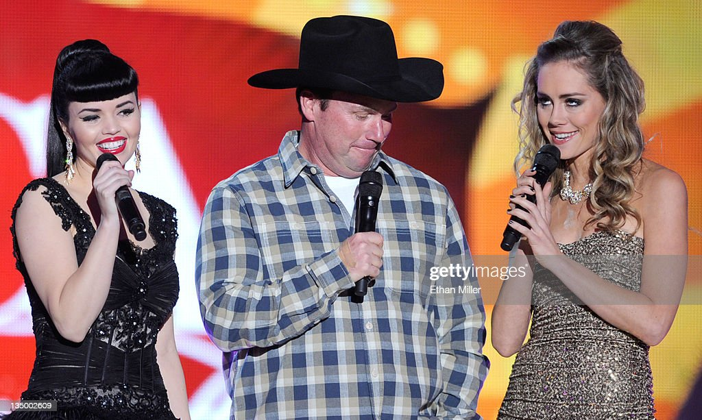 Musicians Susie Brown and Danelle Leverett of the Jane Dear Girls and musician Rodney Carrington (C) speak onstage at the American Country Awards 2011 at the MGM Grand Garden Arena on December 5, 2011 in Las Vegas, Nevada.