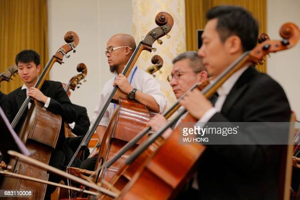 Musicians take part in a rehearsal before a welcome banquet for the Belt and Road Forum at the Great Hall of the People in Beijing on May 14 2017 HONG