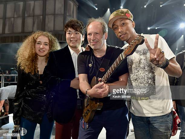 Musicians Tal Wilkenfeld Lang Lang Hans Zimmer and Pharrell Williams pose backstage during The 57th Annual GRAMMY Awards at the Staples Center on...