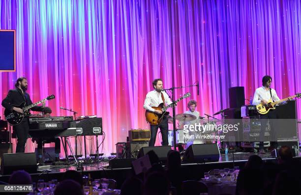 Musicians Taylor Goldsmith Griffin Goldsmith Wylie Gelber of Dawes perform onstage at the Venice Family Clinic Silver Circle Gala 2017 honoring Sue...