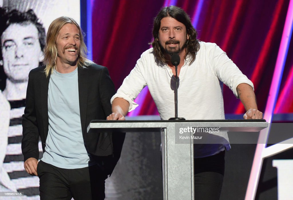 Musicians <a gi-track='captionPersonalityLinkClicked' href=/galleries/search?phrase=Taylor+Hawkins&family=editorial&specificpeople=220594 ng-click='$event.stopPropagation()'>Taylor Hawkins</a> (L) and <a gi-track='captionPersonalityLinkClicked' href=/galleries/search?phrase=Dave+Grohl&family=editorial&specificpeople=202539 ng-click='$event.stopPropagation()'>Dave Grohl</a> speak onstage during the 28th Annual Rock and Roll Hall of Fame Induction Ceremony at Nokia Theatre L.A. Live on April 18, 2013 in Los Angeles, California.
