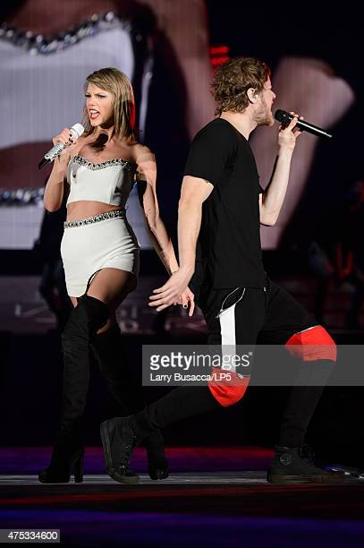 Musicians Taylor Swift and Dan Reynolds of Imagine Dragons perform on stage during the 1989 World Tour Live at Ford Field on May 30 2015 in Detroit...