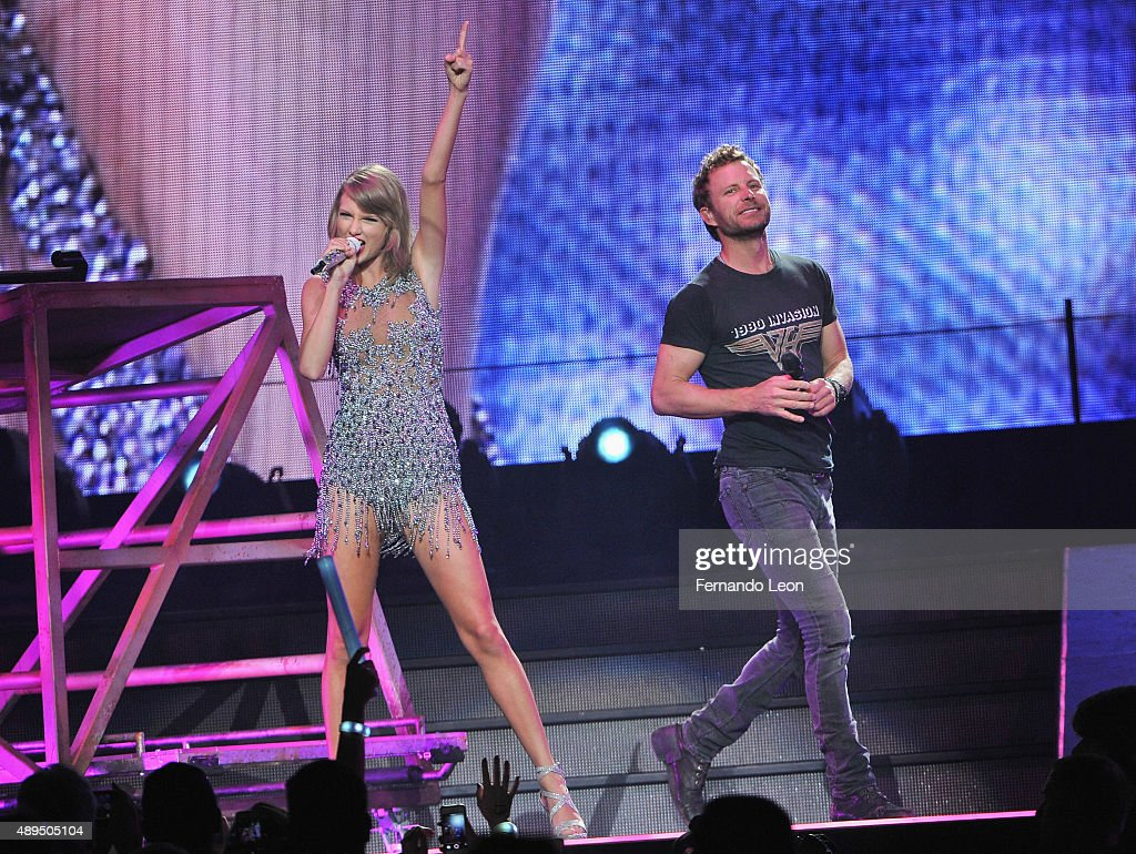 Musicians Taylor Swift and Dierks Bentley perform onstage at the Sprint Center on September 21 2015 in Kansas City Missouri