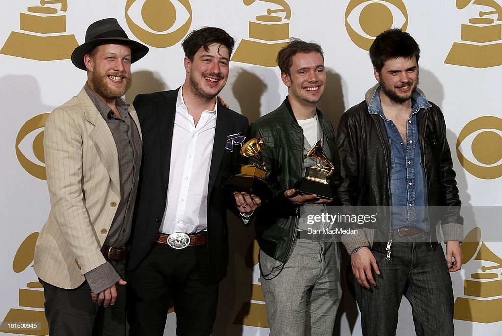 Musicians Ted Dwane, Marcus Mumford, Ben Lovett and Country Winston-Marshall of Mumford & Sons, winners of Best Long Form Music Video and Album of the Year, pose in the press room at the 55th Annual Grammy Awards at the Staples Center on February 10, 2013 in Los Angeles, California.