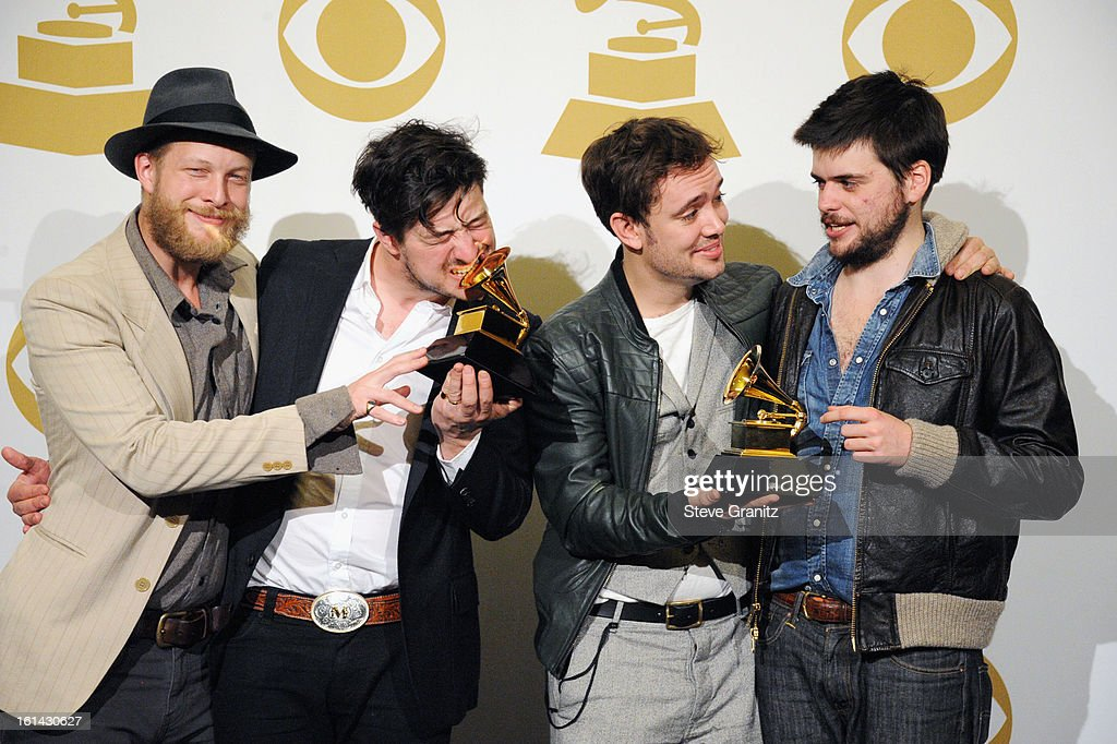 Musicians Ted Dwayne, Marcus Mumford, Ben Lovett and 'Country' Winston Marshall of Mumford and Sons pose in the press room during the 55th Annual GRAMMY Awards at STAPLES Center on February 10, 2013 in Los Angeles, California.