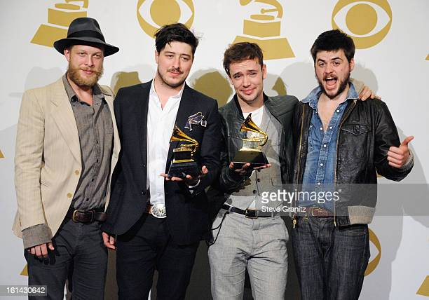 Musicians Ted Dwayne Marcus Mumford Ben Lovett and 'Country' Winston Marshall of Mumford and Sons pose in the press room during the 55th Annual...