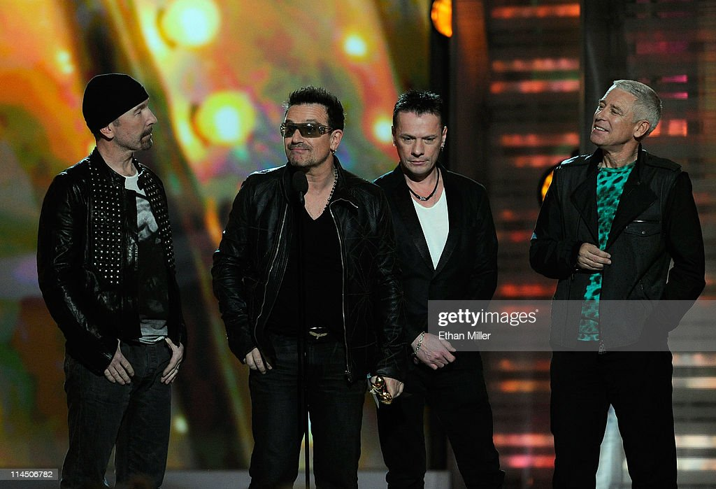 Musicians The Edge, <a gi-track='captionPersonalityLinkClicked' href=/galleries/search?phrase=Bono+-+Singer&family=editorial&specificpeople=167279 ng-click='$event.stopPropagation()'>Bono</a>, <a gi-track='captionPersonalityLinkClicked' href=/galleries/search?phrase=Larry+Mullen+Jr.&family=editorial&specificpeople=211542 ng-click='$event.stopPropagation()'>Larry Mullen Jr.</a> and <a gi-track='captionPersonalityLinkClicked' href=/galleries/search?phrase=Adam+Clayton+-+Musician&family=editorial&specificpeople=204667 ng-click='$event.stopPropagation()'>Adam Clayton</a> of the band U2 accept the Touring Top Artist Award onstage during the 2011 Billboard Music Awards at the MGM Grand Garden Arena May 22, 2011 in Las Vegas, Nevada.