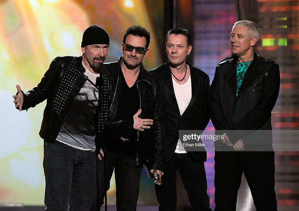 Musicians The Edge Bono Larry Mullen Jr and Adam Clayton of the band U2 accept the Touring Top Artist Award onstage during the 2011 Billboard Music...