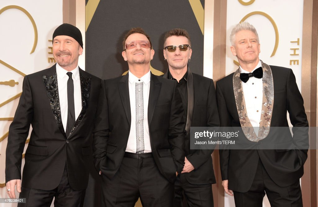 Musicians The Edge Bono Larry Mullen Jr and Adam Clayton of U2 attend the Oscars held at Hollywood Highland Center on March 2 2014 in Hollywood...