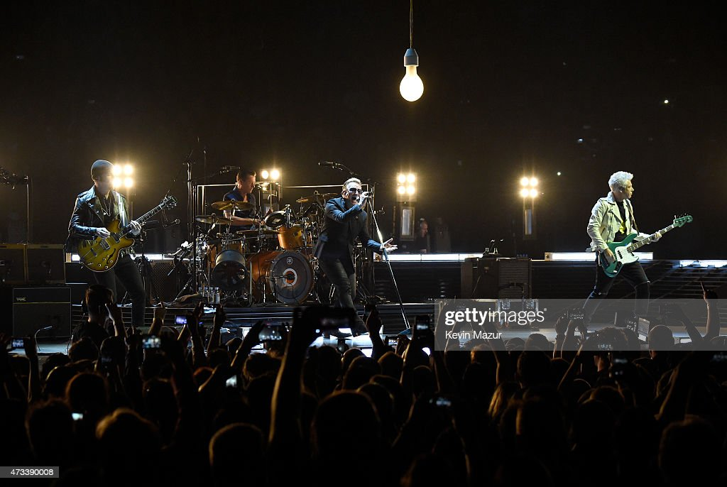 Musicians The Edge Larry Mullen Jr Bono and Adam Clayton of U2 perform onstage during the U2 iNNOCENCE eXPERIENCE tour opener in Vancouver at Rogers...