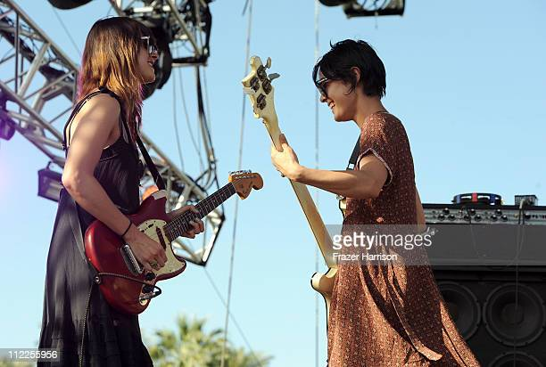 Musicians Theresa Wayman and Jenny Lee Lindberg of the band Warpaint perform during Day 1 of the Coachella Valley Music Arts Festival 2011 held at...