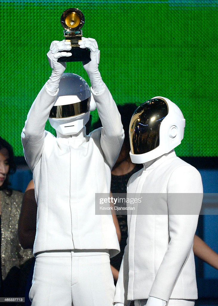 Musicians Thomas Bangalter (L) and Guy-Manuel De Homem-Christo of Daft Punk accept the Album of the Year award for 'Random Access Memories' onstage during the 56th GRAMMY Awards at Staples Center on January 26, 2014 in Los Angeles, California.