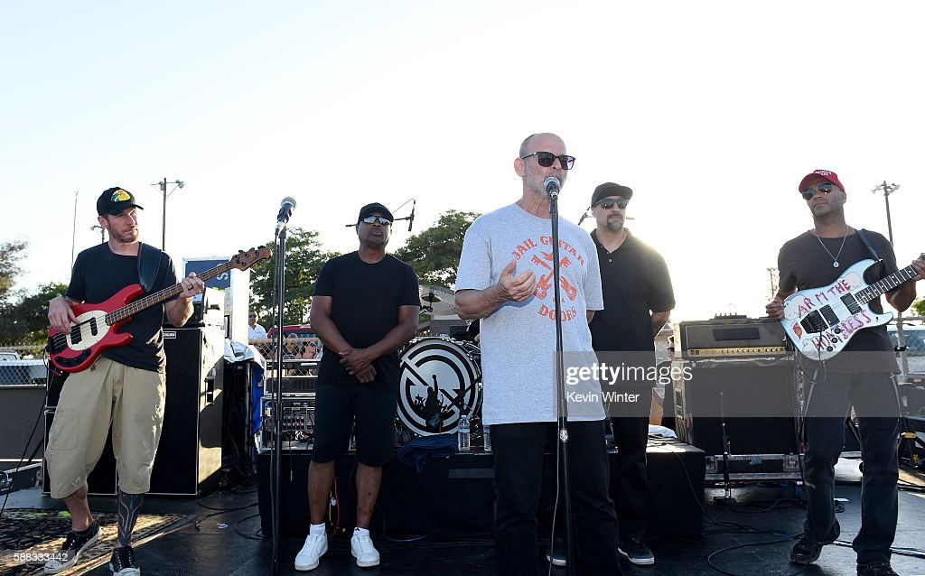 Musicians Tim Commerford, Chuck D, Wayne Kramer, co-founder of Jail Guitars Doors USA, B-Real and Tom Morello of Prophets of Rage appear onstage outside of the California Rehabilitation Center on August 10, 2016 in Norco, California.