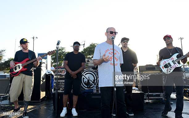 Musicians Tim Commerford Chuck D Wayne Kramer cofounder of Jail Guitars Doors USA BReal and Tom Morello of Prophets of Rage appear onstage outside of...