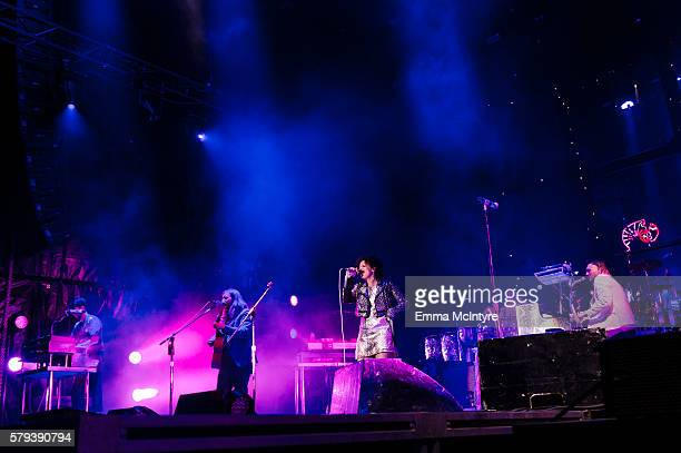 Musicians Tim Kingsbury Regine Chassagne and Win Butler of 'Arcade Fire' perform on Day 2 of the WayHome Music and Arts Festival on July 23 2016 in...