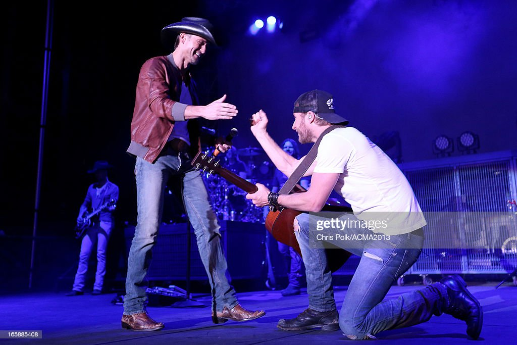 Musicians <a gi-track='captionPersonalityLinkClicked' href=/galleries/search?phrase=Tim+McGraw&family=editorial&specificpeople=202845 ng-click='$event.stopPropagation()'>Tim McGraw</a> and <a gi-track='captionPersonalityLinkClicked' href=/galleries/search?phrase=Dierks+Bentley&family=editorial&specificpeople=243007 ng-click='$event.stopPropagation()'>Dierks Bentley</a> onstage at the ACM Party For A Cause Festival during the 48th Annual Academy of Country Music Awards at the Orleans Arena on April 6, 2013 in Las Vegas, Nevada.