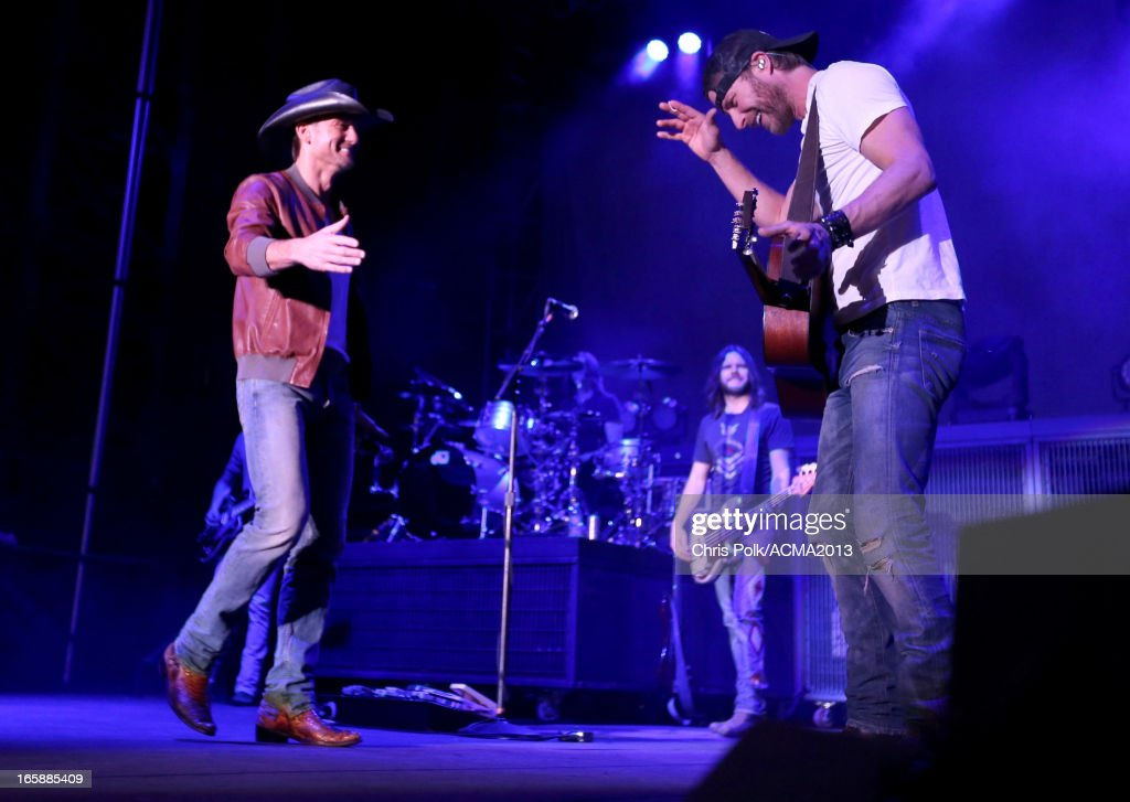 Musicians Tim McGraw and <a gi-track='captionPersonalityLinkClicked' href=/galleries/search?phrase=Dierks+Bentley&family=editorial&specificpeople=243007 ng-click='$event.stopPropagation()'>Dierks Bentley</a> onstage at the ACM Party For A Cause Festival during the 48th Annual Academy of Country Music Awards at the Orleans Arena on April 6, 2013 in Las Vegas, Nevada.