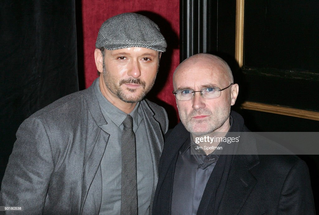 Musicians Tim McGraw and Phil Collins attend 'The Blind Side' premiere at the Ziegfeld Theatre on November 17, 2009 in New York City.