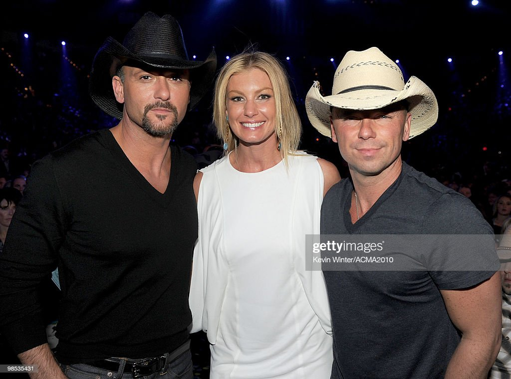 Musicians <a gi-track='captionPersonalityLinkClicked' href=/galleries/search?phrase=Tim+McGraw&family=editorial&specificpeople=202845 ng-click='$event.stopPropagation()'>Tim McGraw</a>, <a gi-track='captionPersonalityLinkClicked' href=/galleries/search?phrase=Faith+Hill&family=editorial&specificpeople=175933 ng-click='$event.stopPropagation()'>Faith Hill</a>, and <a gi-track='captionPersonalityLinkClicked' href=/galleries/search?phrase=Kenny+Chesney&family=editorial&specificpeople=209324 ng-click='$event.stopPropagation()'>Kenny Chesney</a> pose in the audience during the 45th Annual Academy of Country Music Awards at the MGM Grand Garden Arena on April 18, 2010 in Las Vegas, Nevada.