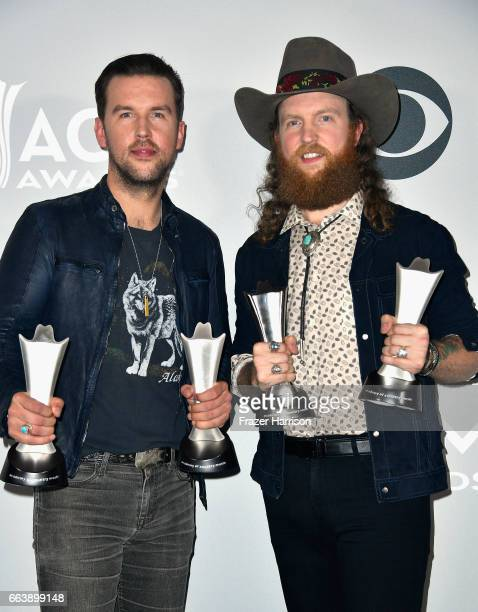Musicians TJ Osborne and John Osborne of the music group Brothers Osborne winners of the Vocal Duo of the Year award pose in the press room during...