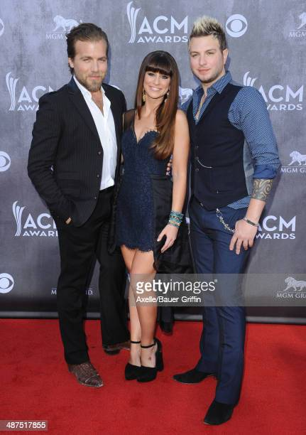 Musicians Tom Gossin Rachel Reinert and Mike Gossin of Gloriana arrive at the 49th Annual Academy of Country Music Awards at the MGM Grand Hotel and...