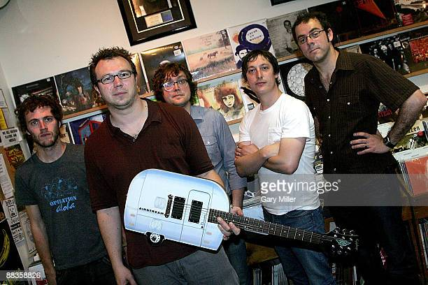 Musicians Tom Gray Ian Ball Ben Ottewell Olly Peacock and Paul Blackburn of Gomez are presented with an Epiphone Airstream to commemorate their new...