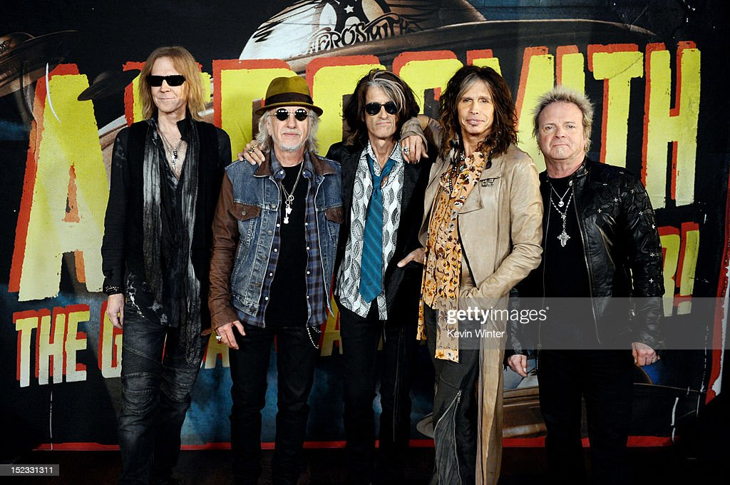 Musicians Tom Hamilton, Brad Whitford, Joe Perry, Steven Tyler and Joey Kramer of Aerosmith pose at the press junket to announce their new album 'Music From Another Dimension' and upcoming dates for their 'Global Warming' tour at the House of Blues on September 18, 2012 in West Hollywood, California.