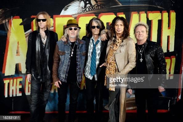 Musicians Tom Hamilton Brad Whitford Joe Perry Steven Tyler and Joey Kramer of Aerosmith pose at the press junket to announce their new album 'Music...