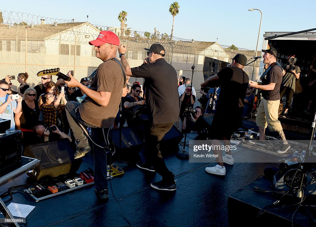 Musicians Tom Morello, B-Real, Chuck D and Tim Commerford of Prophets of Rage perform outside of the California Rehabilitation Center on August 10, 2016 in Norco, California.