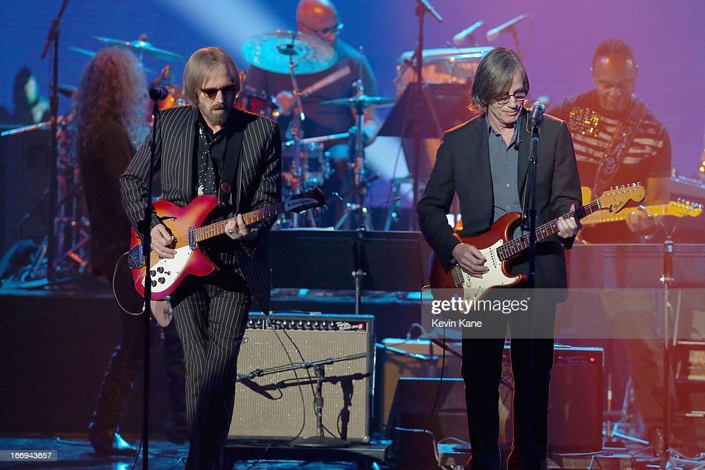 Musicians Tom Petty and Jackson Browne perform at the 28th Annual Rock and Roll Hall of Fame Induction Ceremony at Nokia Theatre L.A. Live on April 18, 2013 in Los Angeles, California.