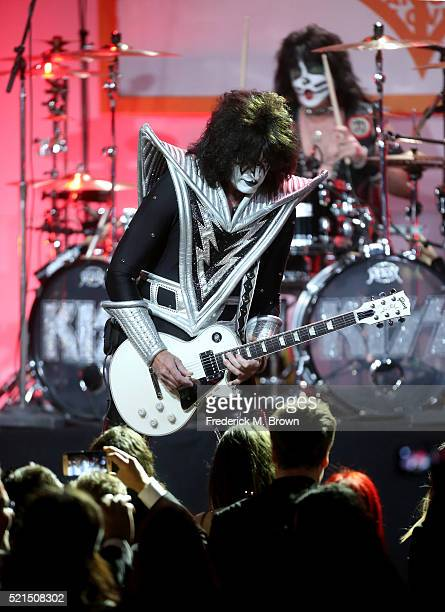 Musicians Tommy Thayer and Eric Singer of KISS perform onstage during the 23rd Annual Race To Erase MS Gala at The Beverly Hilton Hotel on April 15...