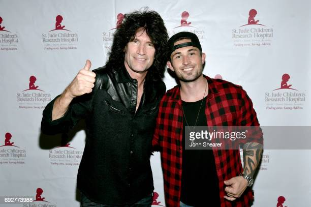 Musicians Tommy Thayer and Michael Ray take photos backstage during the 8th annual Darius Friends concert to benefit St Jude's Children's Research...