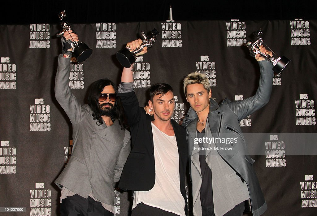 Musicians Tomo Milicevic, Shannon Leto and Jared Leto of 30 Seconds to Mars poses in the press room with their award for Best Rock Video during the MTV Video Music Awards at NOKIA Theatre L.A. LIVE on September 12, 2010 in Los Angeles, California.