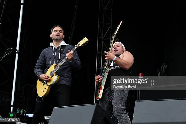 Musicians Travis Miguel and Dan Jacobs from Atreyu performs during the 'Louder Than Life' festival at Champions Park on October 3 2015 in Louisville...