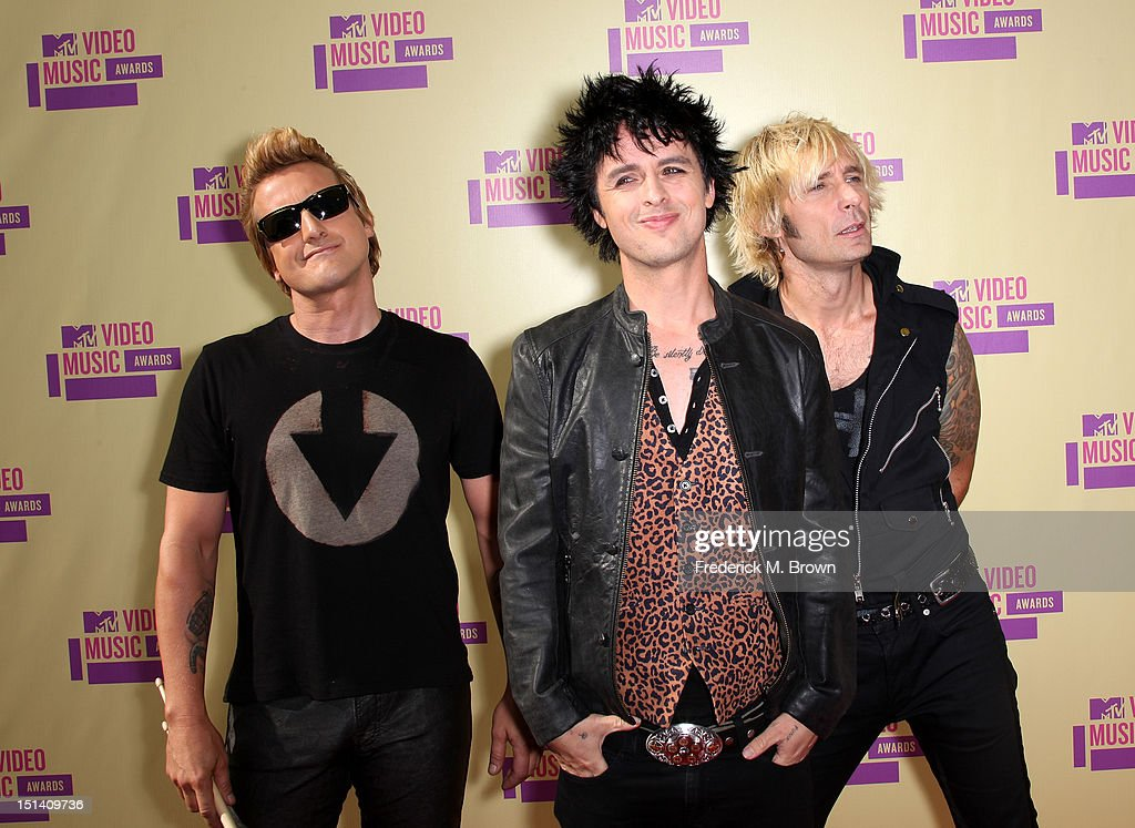 Musicians Tre Cool, <a gi-track='captionPersonalityLinkClicked' href=/galleries/search?phrase=Billie+Joe+Armstrong&family=editorial&specificpeople=201545 ng-click='$event.stopPropagation()'>Billie Joe Armstrong</a> and <a gi-track='captionPersonalityLinkClicked' href=/galleries/search?phrase=Mike+Dirnt&family=editorial&specificpeople=204154 ng-click='$event.stopPropagation()'>Mike Dirnt</a> of Green Day arrive at the 2012 MTV Video Music Awards at Staples Center on September 6, 2012 in Los Angeles, California.