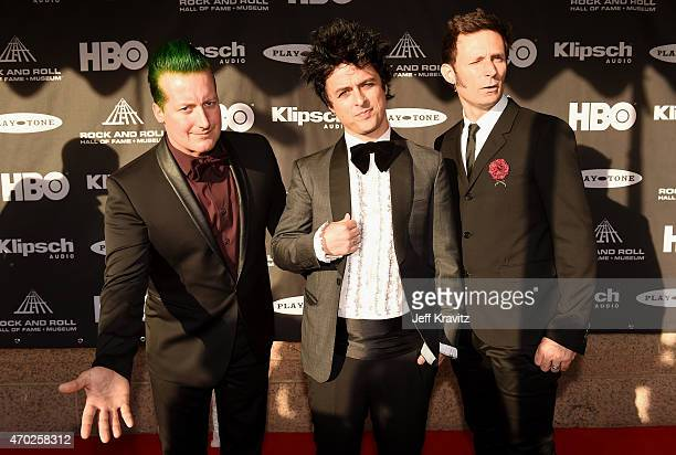 Musicians Tre Cool Billie Joe Armstrong and Mike Dirnt of Green Day attend the 30th Annual Rock And Roll Hall Of Fame Induction Ceremony at Public...