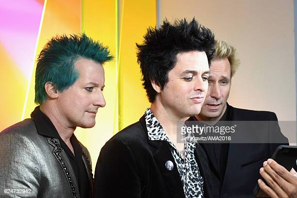 Musicians Tre Cool Billie Joe Armstrong and Mike Dirnt of Green Day attend the 2016 American Music Awards at Microsoft Theater on November 20 2016 in...