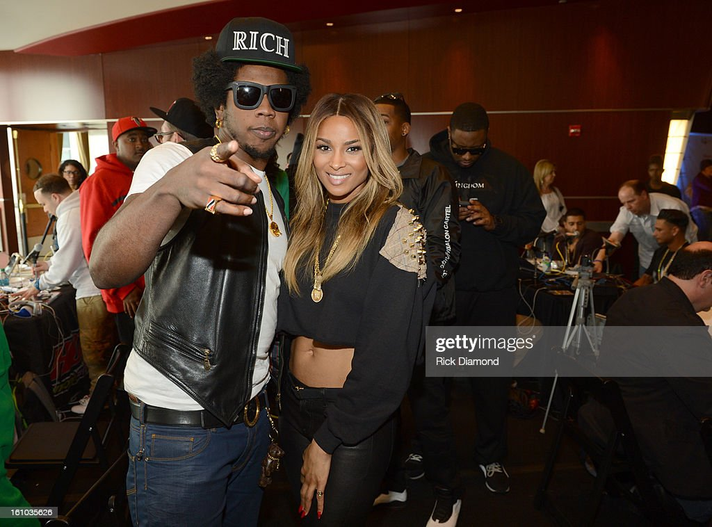 Musicians Trinidad James and Ciara pose backstage at the GRAMMYs Dial Global Radio Remotes during The 55th Annual GRAMMY Awards at the STAPLES Center on February 8, 2013 in Los Angeles, California.