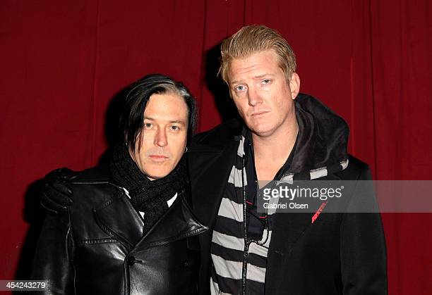 Musicians Troy Van Leeuwen and Josh Homme of Queens of the Stone Age pose backstage during The 24th Annual KROQ Almost Acoustic Christmas at The...