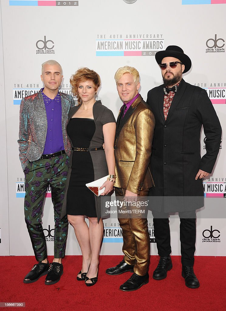 Musicians <a gi-track='captionPersonalityLinkClicked' href=/galleries/search?phrase=Tyler+Glenn&family=editorial&specificpeople=5680345 ng-click='$event.stopPropagation()'>Tyler Glenn</a>, <a gi-track='captionPersonalityLinkClicked' href=/galleries/search?phrase=Elaine+Bradley&family=editorial&specificpeople=7159725 ng-click='$event.stopPropagation()'>Elaine Bradley</a>, Chris Allen, and <a gi-track='captionPersonalityLinkClicked' href=/galleries/search?phrase=Branden+Campbell&family=editorial&specificpeople=5680344 ng-click='$event.stopPropagation()'>Branden Campbell</a> of Neon Trees attend the 40th American Music Awards held at Nokia Theatre L.A. Live on November 18, 2012 in Los Angeles, California.