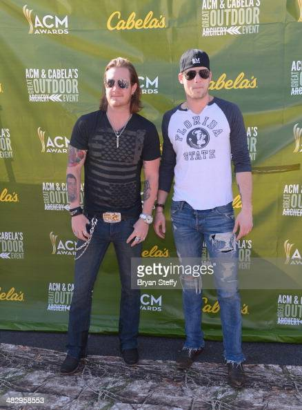 Musicians Tyler Hubbard and Brian Kelley from the band Florida Georgia Line attend the ACM Cabela's Great Outdoor Archery Event during the 49th...