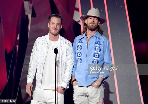 Musicians Tyler Hubbard and Brian Kelley of Florida Georgia Line speak onstage at the 2017 iHeartRadio Music Awards which broadcast live on Turner's...