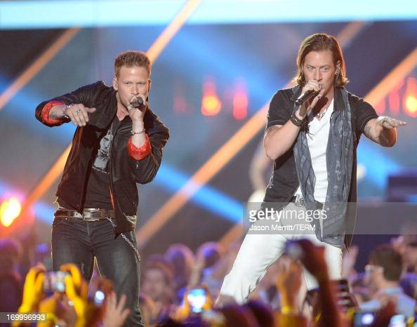 Musicians Tyler Hubbard and Brian Kelley of Florida Georgia Line perform onstage during the 2013 CMT Music awards at the Bridgestone Arena on June 5...