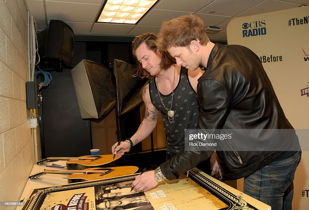 Musicians Tyler Hubbard and Brian Kelley of Florida Georgia Line sign autographs backstage during CBS Radio's The Night Before at US Airways Center...