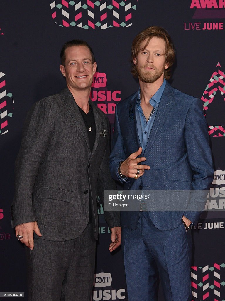 Musicians Tyler Hubbard and Brian Kelley of Florida Georgia Line attend the 2016 CMT Music awards at the Bridgestone Arena on June 8 2016 in...