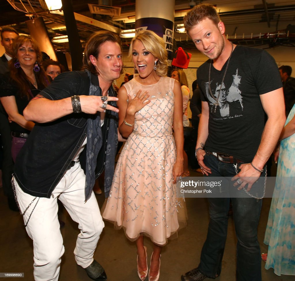 Musicians <a gi-track='captionPersonalityLinkClicked' href=/galleries/search?phrase=Tyler+Hubbard&family=editorial&specificpeople=9453787 ng-click='$event.stopPropagation()'>Tyler Hubbard</a> (L) and Brian Kelley (R) of Florida Georgia Line with <a gi-track='captionPersonalityLinkClicked' href=/galleries/search?phrase=Carrie+Underwood&family=editorial&specificpeople=204483 ng-click='$event.stopPropagation()'>Carrie Underwood</a> at the 2013 CMT Music awards at the Bridgestone Arena on June 5, 2013 in Nashville, Tennessee.