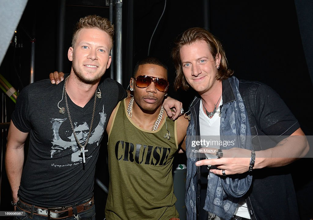 Musicians <a gi-track='captionPersonalityLinkClicked' href=/galleries/search?phrase=Tyler+Hubbard&family=editorial&specificpeople=9453787 ng-click='$event.stopPropagation()'>Tyler Hubbard</a>, Nelly and Brian Kelley pose backstage at the 2013 CMT Music awards at the Bridgestone Arena on June 5, 2013 in Nashville, Tennessee.
