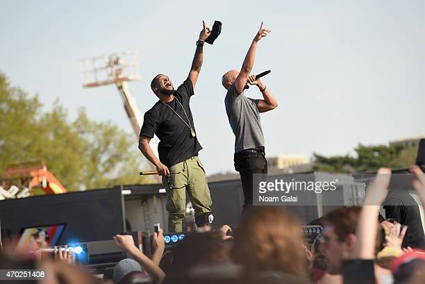 Musicians Usher and Common perform onstage during Global Citizen 2015 Earth Day on National Mall to end extreme poverty and solve climate change on...